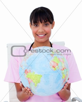 Portrait of an ethnic female doctor holding a terrestrial globe