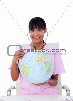 Portrait of an ambitious doctor examining a terrestrial globe