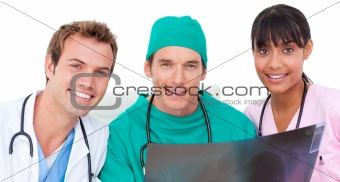 Portrait of medical team looking at X-ray