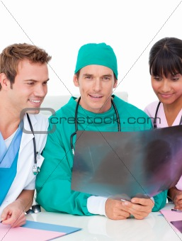 Ambitious medical team looking at X-ray