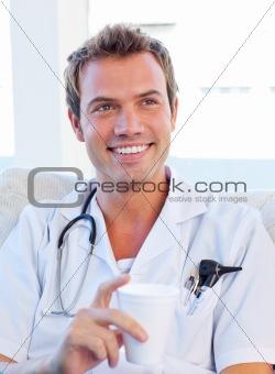 Charismatic doctor having a break