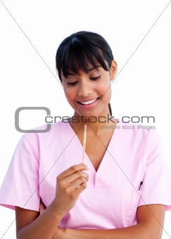 Portrait of an attractive nurse holding a thermometer