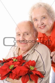 shot of an eldery couple with flowers vertical