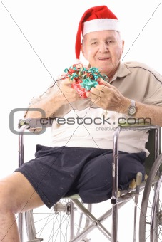 shot of an eldery man in wheelchair celebrating christmas vertical
