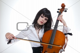 Portrait of attractive girl playing cello