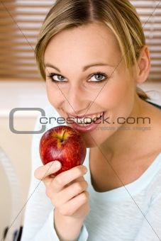 Beautiful Young Woman Holding an Apple and Watching Direct to Ca