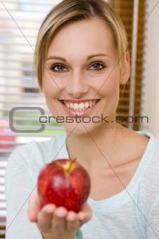 Beautiful Healthy Woman Holding an Apple on Front