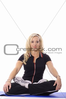 shot of a blonde woman meditating