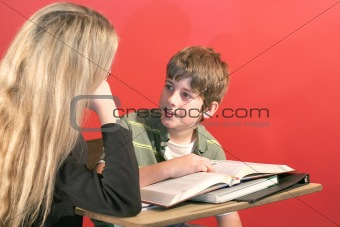 shot of a mother and son doing homework smile