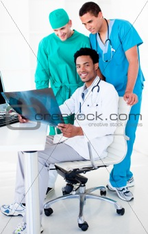 Positive male doctors looking at X-Ray