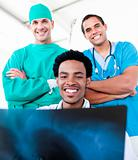 Smiling male doctors looking at X-Ray