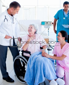 Charming medical team taking care of a senior woman