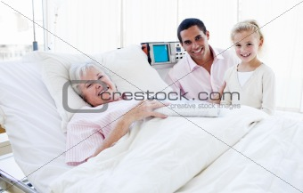Smiling little girl with her father visiting her grandmother