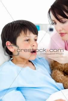 Young nurse taking her patient's temperature