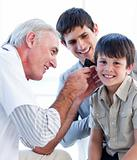 Senior doctor examining a little boy's ears