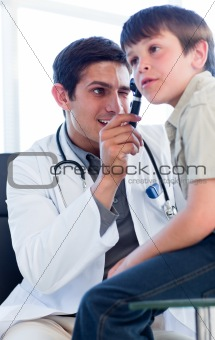 Charismatic doctor examining little boy's ears