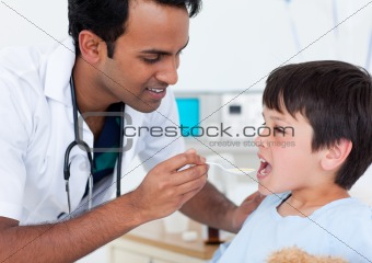 Attractive doctor giving medicine to a little boy