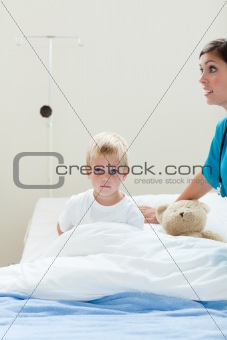 Portrait of a sick little boy on a hospital bed