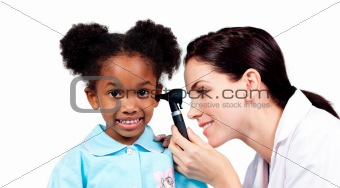 Smiling doctor checking her patient's ears
