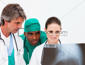 Medical team examining an x-ray