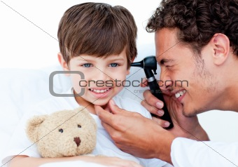 Attractive doctor examining patient's ears
