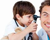 Cute child checking doctor&#39;s ears