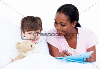 Adorable little boy with his doctor