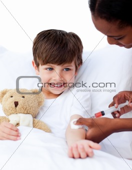Afro-american female doctor giving a child an injection