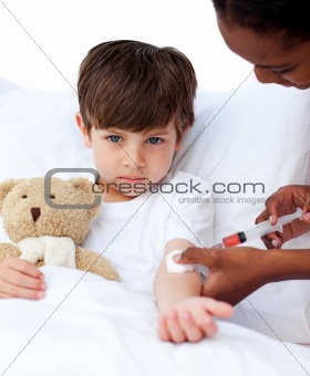 Adorable little boy receiving an injection