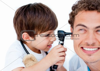 Cute little boy playing with his doctor