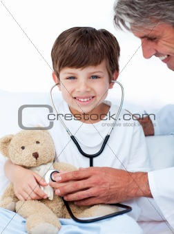 Adorable Little boy playing with his doctor