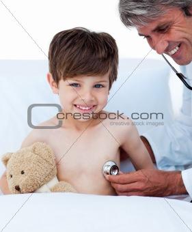 Little boy attending a medical check-up