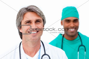 Smiling male doctors standing in a line