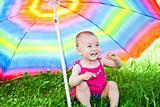 Hiding under a colorful umbrella