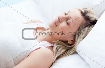Portrait of an attractive woman relaxing lying on a sofa