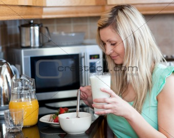 Charming woman having an healthy breakfast in a kitchen