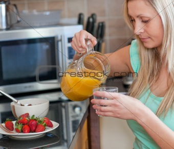 Attractive woman having an healthy breakfast in a kitchen