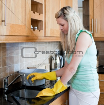 Young woman cleaning a kitchen