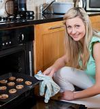 Happy woman baking cookies