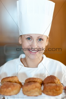 Charming young chef baking scones