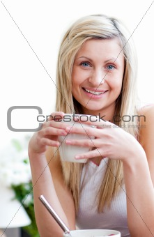 Beautiful woman holding a cup of coffee against a white background
