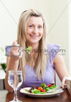 Cute woman having an healthy dinner
