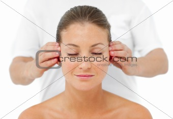 Attractive woman having a head massage