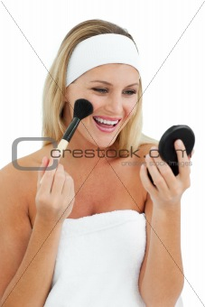 Blond woman putting on make-up