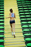 woman jogging at athletics stadium