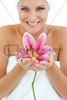 Bright woman holding a flower