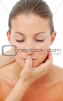 Charming woman having a head massage in a spa