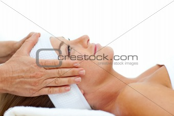 Attractive woman enjoying a head massage