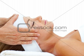 Attractive woman relaxing with head massage