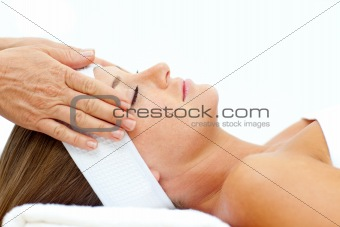 Asleep woman relaxing with head massage